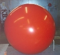 7ft. red helium balloon from $269.00. 7ft. balloon with artwork or lettering from $533.00. Reusable.