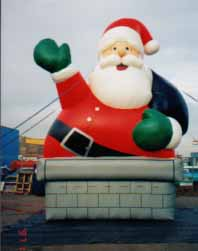 Santa balloons for rent - 20ft. Chimney Santa Claus inflatables.