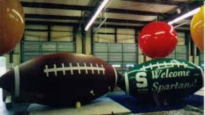 Football balloons - helium football inflatables made in the USA.