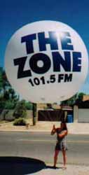 Helium advertising balloon with Radio Station logo